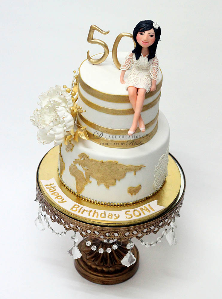 White & Gold Around the World Cake
